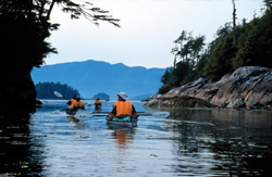 Sea kayak touring in the Broken Group Islands, British Columbia.